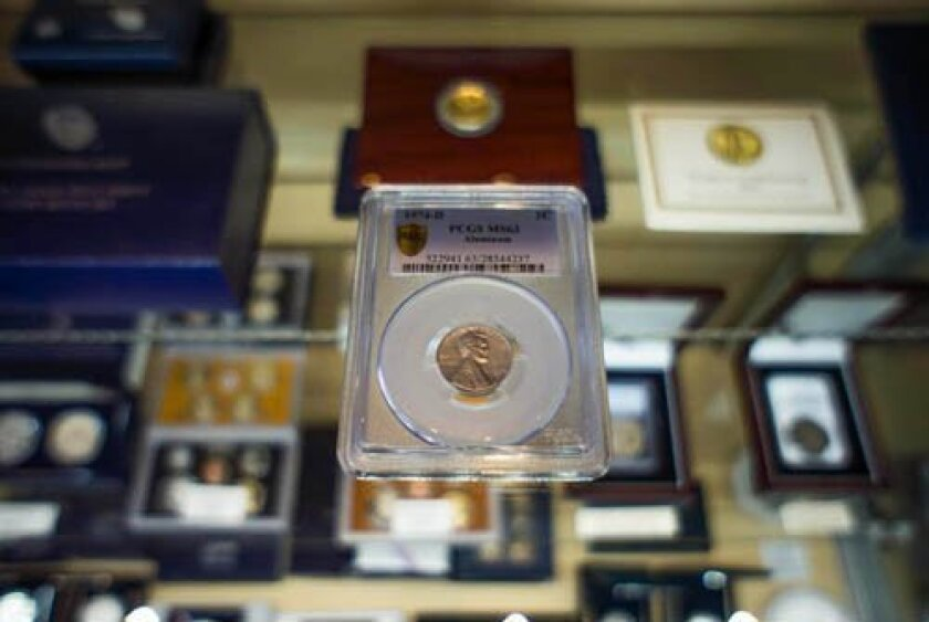 Randy Lawrence's 1974 aluminum penny is thought to be the only one in existence minted in Denver. His father, who worked at the U.S. mint there, left it for his son. It is estimated to be worth well over $250,000. Photo by Kristoffer Newsom