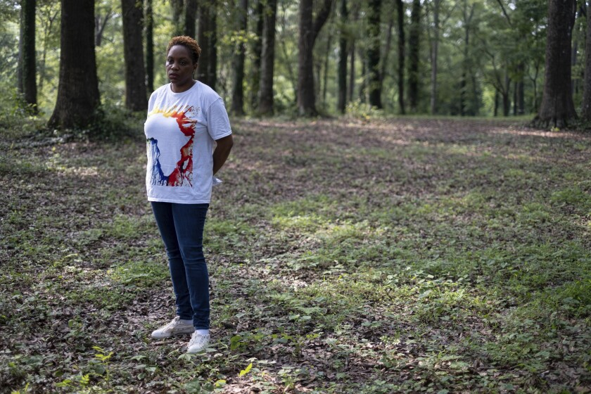 Ayisat Idris-Hosch stands at the Farmer Street Cemetery, a historic slave cemetery, in Newnan, Ga., on Monday, July 26, 2021, before a protest against a new skate park that is being built adjacent to the cemetery. Idris-Hosch said the city did not seek sufficient community input before beginning the project. (AP Photo/Ben Gray)