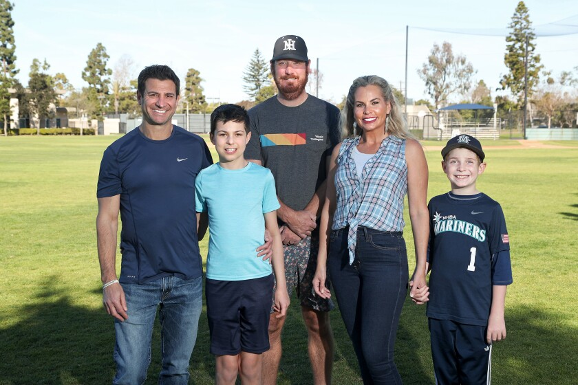 Newport Harbor Baseball Assn. President Jared Eisenberg with the Tarman family: Dan, son, Leo, wife, Alicia, and son, Miles.