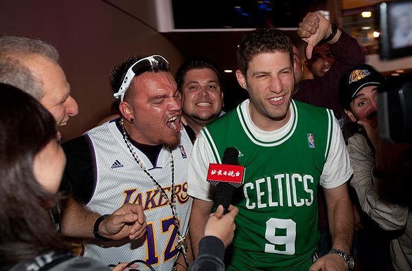 Richard Cuevas, of Downey, (left) hassles Jon Salett, of Chicago, while trying to do a television interview after the Lakers defeated the Celtics in Game 6 of the NBA Finals held at the Staples Center on Tues., June 15, 2010, in Los Angeles.