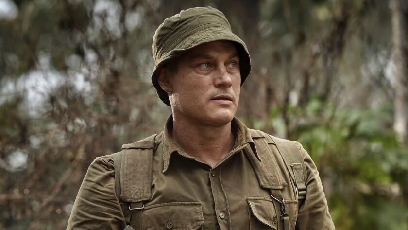 "Travis Fimmel as Major Harry Smith in the Vietnam War movie ""Danger Close."""