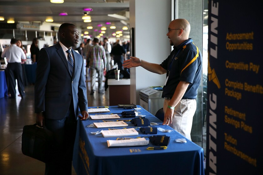 A job seeker meets with a Goodyear recruiter during the Hiring Our Heroes Job Fair at AT&T Park on Aug. 25 in San Francisco.