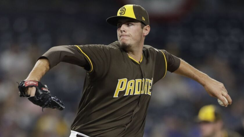 San Diego Padres relief pitcher Brad Wieck works against a Texas Rangers batter as he makes his major league debut during the eighth inning of a baseball game Friday, Sept. 14, 2018, in San Diego.