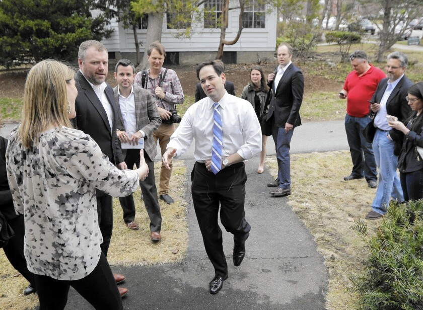 Republican presidential candidate Sen. Marco Rubio of Florida arrives at a campaign house party in New Hampshire.