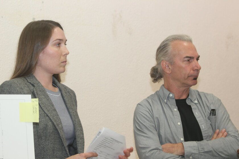 Project designers Hilary Lowe and Michael Shumard listen as La Jolla Community Planning Association trustees debate the merits of their revised plans for a two-story home in La Jolla Shores.
