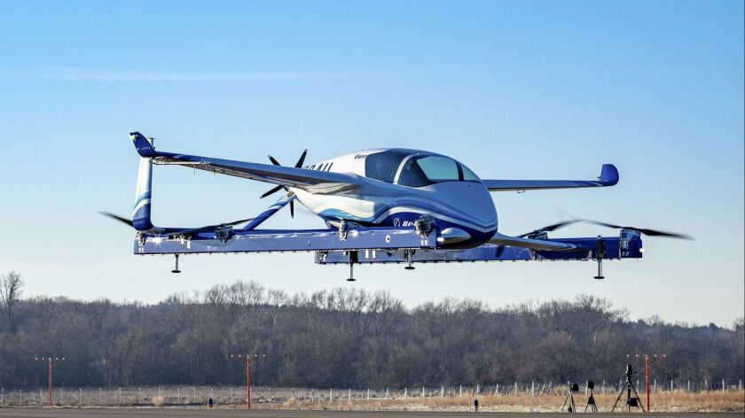 "A prototype ""flying car"" by Boeing. The aircraft manufacturer said that the prototype on Tuesday completed its first successful test flight,."