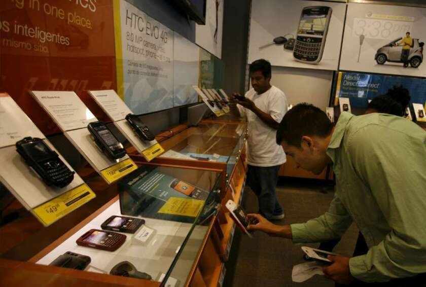Customers shop for phones at a Sprint Corp. store in Silver Lake.