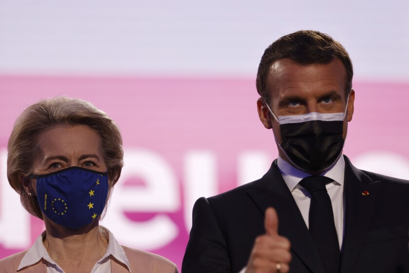 European Commission President Ursula von der Leyen and French President Emmanuel Macron attend Europe Day ceremony and the Future of Europe conference at the European Parliament in Strasbourg, eastern France, Sunday, May 9, 2021. (AP Photo/Jean-Francois Badias, Pool)
