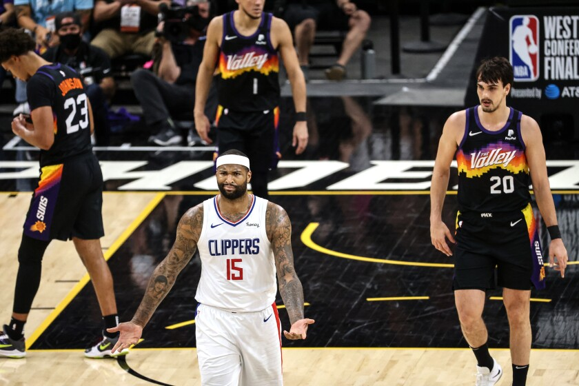 Clippers center DeMarcus Cousins grimaces and turns both palms upward in showing his frustration against Phoenix.
