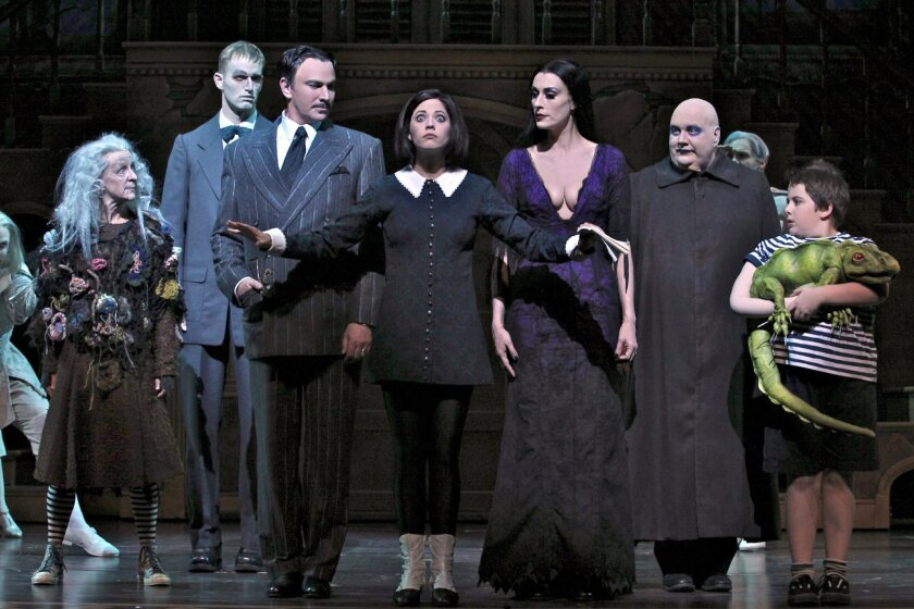 """Pippa Pearthree, Tom Corbeil, Douglas Sills, Cortney Wolfson, Sara Gettelfinger, Blake Hammond and Patrick D. Kennedy (left to right) in the musical """"The Addams Family."""""""