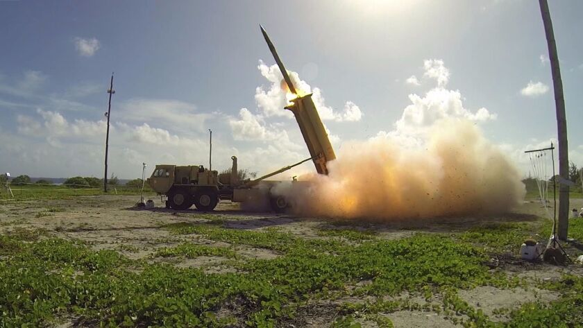 A terminal High Altitude Area Defense (THAAD) interceptor is launched from a THAAD battery located o