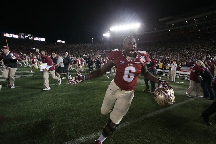 Florida State defensive end Dan Hicks storms the field with the rest of the team after beating Auburn 34-31 in the BCS National Championship at the Rose Bowl.