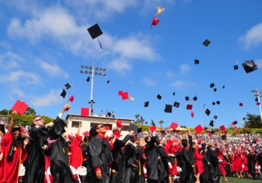 The traditional large in-person graduation ceremony like this at La Jolla High School in 2014 won't happen next month due to the coronavirus. What form the 2020 graduation will take is being determined.