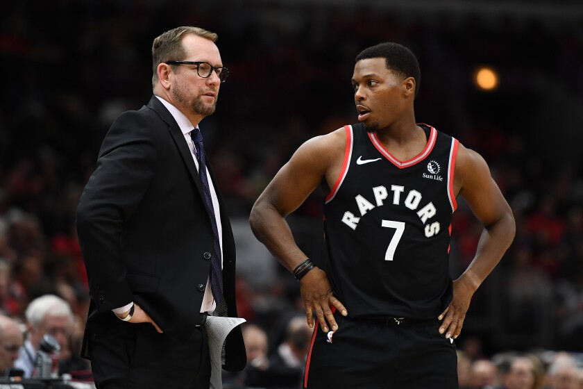 Raptors coach Nick Nurse and point guard Kyle Lowry talk during a break in play against the Chicago Bulls on Oct. 26, 2019.