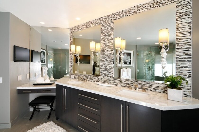The master bath has an espresso finish on the cabinetry and white Carrera marble on the counters and shower walls.