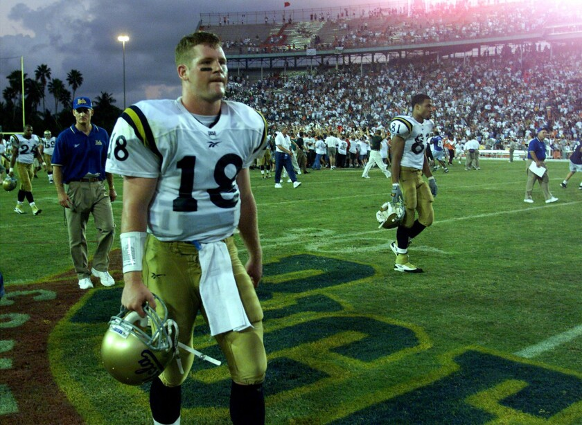 UCLA quarterback Cade McNown walks off the field after a 49–45 loss to Miami at the Orange Bowl in 1998.