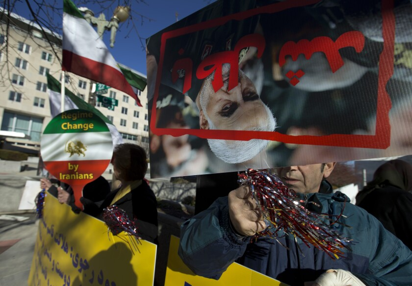 Member of the Iranian American community of Washington DC area rally outside the State Department in Washington, Monday, Jan. 6, 2020, in solidarity with the people of Iran, Syria and Iraq who celebrate the death of Iranian official, Gen. Qassem Soleimani. (AP Photo/Jose Luis Magana)