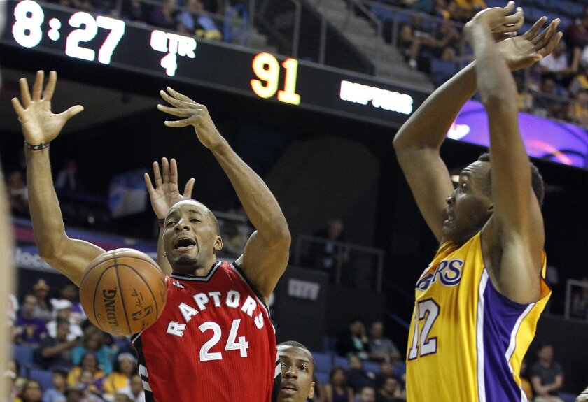Lakers center Robert Upshaw, right, knocks the ball away from Raptors guard Norman Powell during a preseason game on Oct. 8 in Ontario.