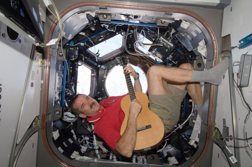 Astronaut Chris Hadfield will offer fans a special book deal via Twitter.
