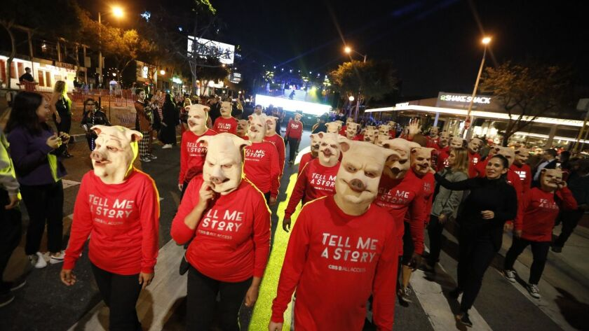 Thousands of people crowded Santa Monica Boulevard on Wednesday evening for West Hollywood's annual Halloween Carnaval.
