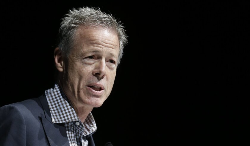 """FILE - In this June 18, 2014, file photo, Jeffrey Bewkes, Chairman and CEO of Time Warner, attends the Cannes Lions 2014, 61st International Advertising Festival in Cannes, southern France. Fans of superhero shows based in the DC Comics universe like """"The Flash,"""" ''Arrow"""" and """"Gotham"""" might have to"""