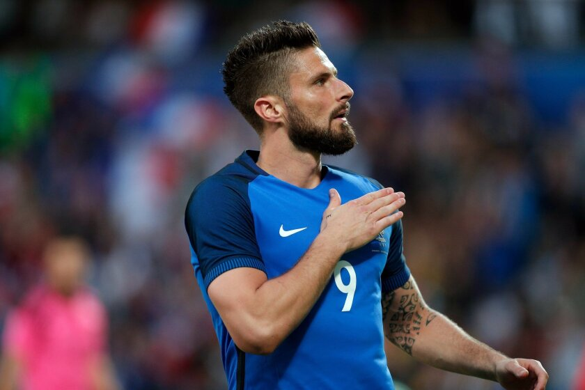 France's Olivier Giroud celebrates after scoring during the friendly soccer match between France and Scotland at the Saint Symphorien Stadium in Metz, eastern France, Saturday, June 4, 2016. The French squad is in preparation for the EURO 2016 soccer championships which will start on June 10, 2016.