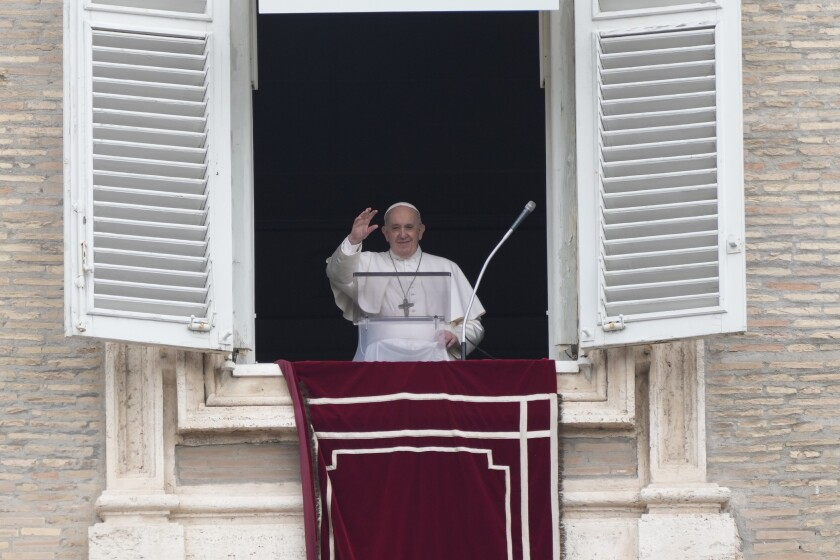 FILE - In this June 29, 2021, file photo, Pope Francis salutes from the window of his studio overlooking St. Peter's square at the Vatican, as he recites the Angelus prayer. The Vatican has detailed laws, rituals and roles to ensure the transfer of power when a pope dies or resigns. Even though Pope Francis is recovering from intestinal surgery in a Rome hospital, he is still very much in charge. (AP Photo/Gregorio Borgia, File)