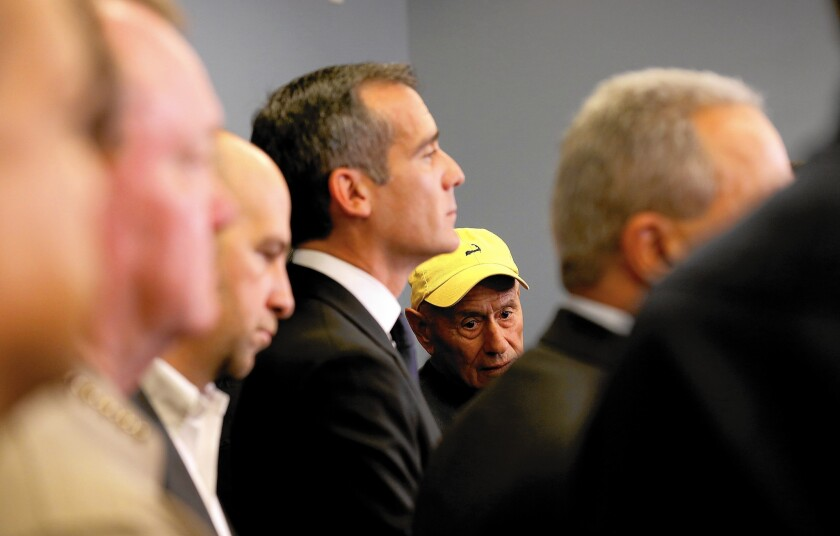 "Supt. Ramon Cortines made the ultimate call to close L.A. Unified's schools. Mayor Eric Garcetti, foreground, said of school officials, ""It's their decision to make."""