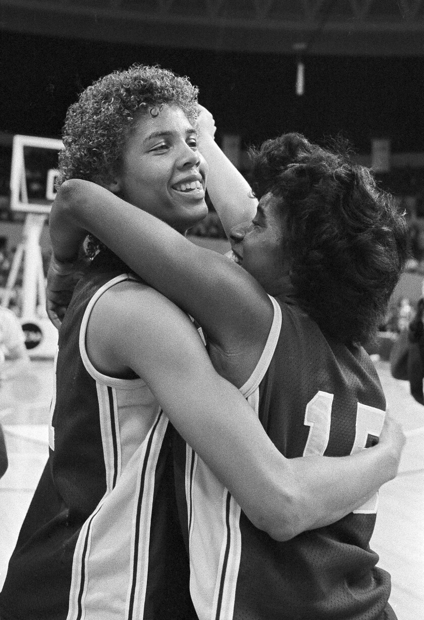 USC's Cheryl Miller, left, gets a hug from teammate Juliette Robinson after they defeated Georgia to move to the final game of the NCAA women's basketball tournament, in Norfolk, Va., on April 1, 1983.