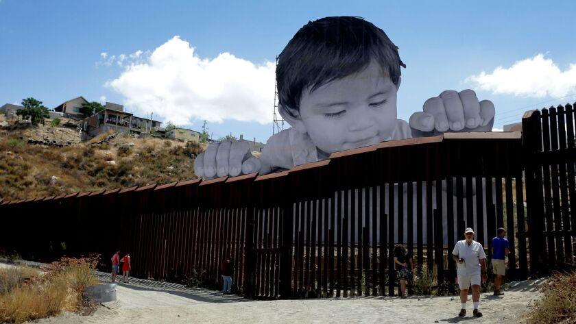 Art installation at border wall between Mexico and California