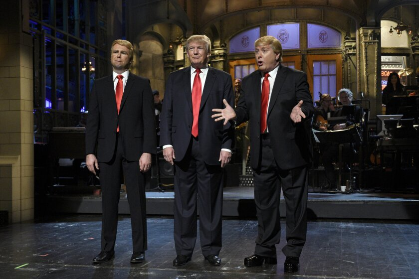 "Taran Killam, left, Republican presidential candidate and guest host Donald Trump, center, and Darrell Hammond perform during the monologue on ""Saturday Night Live."""