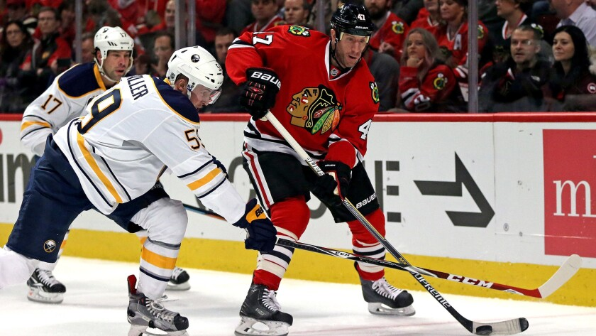Defenseman Rob Scuderi will go from one playoff contender, the Blackhawks, to the Kings, whom he helped win the Stanley Cup in 2012.