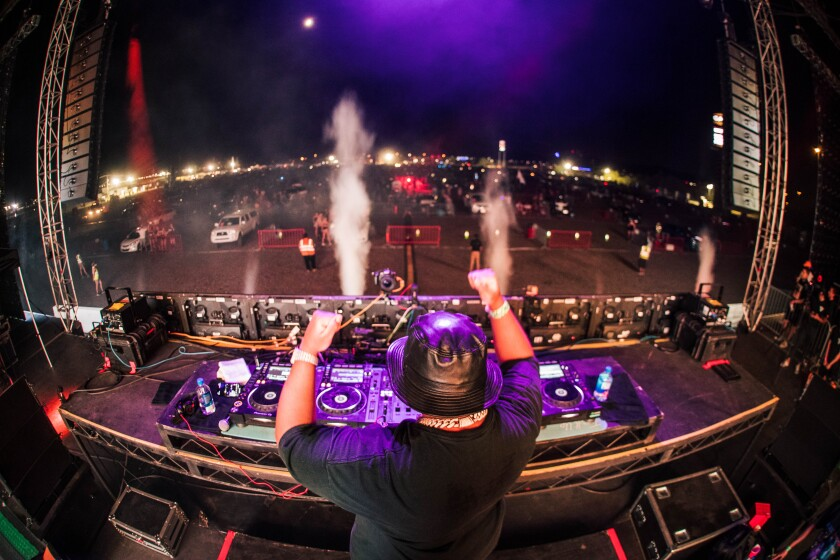 "DJ Carnage leads a drive-in ""Road Rave"" concert in Arizona."