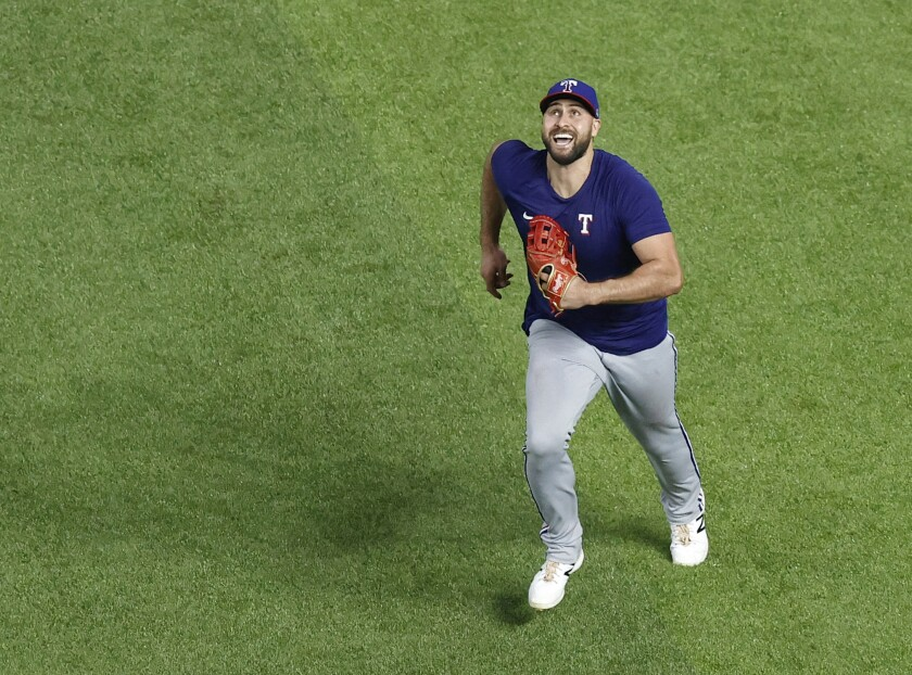 "Texas Rangers outfielder Joey Gallo chases a fly ball during a ""summer camp"" baseball practice inside Globe Life Field in Arlington, Texas, Friday, July 10, 2020. (Tom Fox/The Dallas Morning News via AP)"
