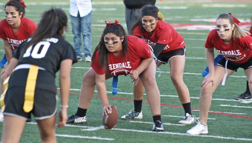 Quarterback Kathleen Hulguin prepares to get the snap from center Jasmine Villalobos