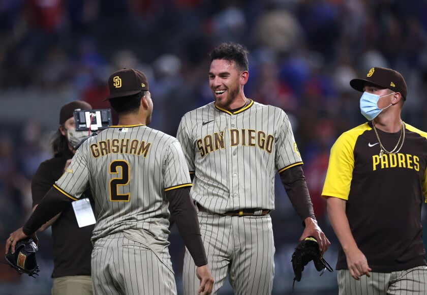 Joe Musgrove celebrates with Trent Grisham after pitching no-hitter against the Texas Rangers at Globe Life Field on Friday.