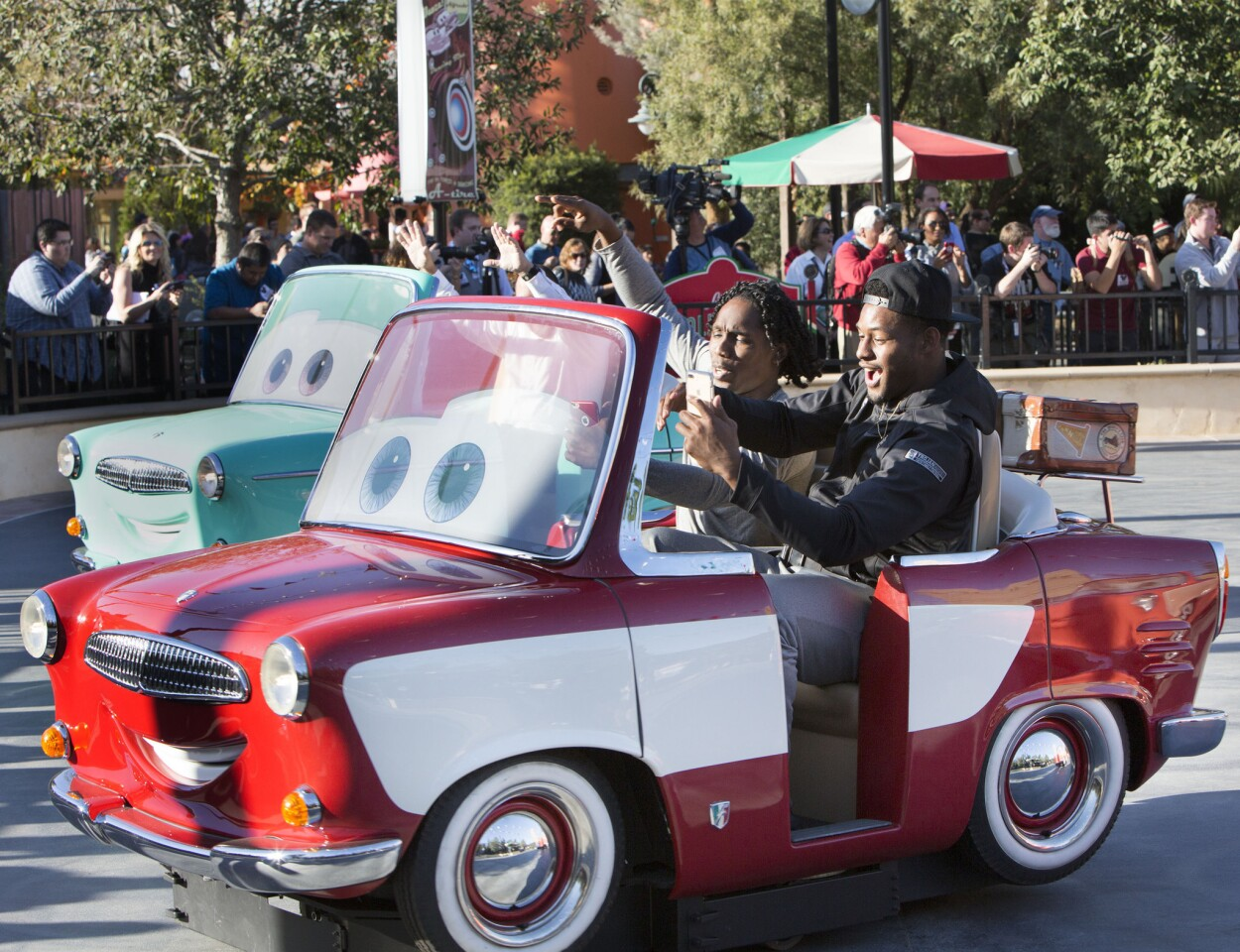 ROSE BOWL TEAMS VISIT DISNEYLAND RESORT (Dec. 27, 2016) – University of Southern California defensive back Adoree' Jackson and wide receiver JuJu Smith-Schuster (left to right) take a spin on Luigi's Rollickin' Roadsters at Disney California Adventure Park in Anaheim, Calif. No. 5 Penn State and No. 9 University of Southern California made their first official appearances of the Rose Bowl Game week on Tuesday at Disney California Adventure Park in Anaheim, Calif. with a special ceremony. The teams will play in the 103rd Rose Bowl Game on Monday, Jan. 2, 2017. (Scott Brinegar/Disneyland Resort)