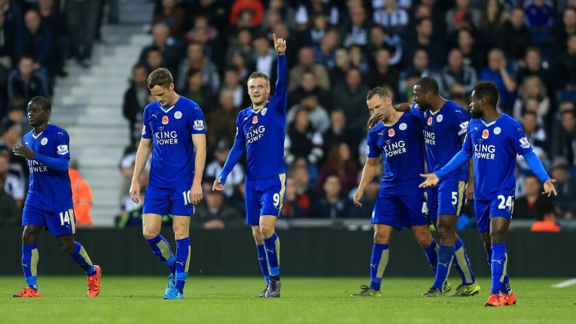 Leicester City's Jamie Vardy, center, celebrates scoring his side's third goal of the game during their English Premier League soccer match against West Bromwich Albion at The Hawthorns, West Bromwich, England, Saturday, Oct. 31, 2015. (Nigel French/PA via AP)     UNITED KINGDOM OUT     -     NO SA