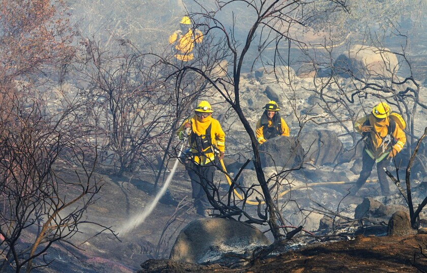 Firefighters on Friday battled a blaze that started near Cole Grade Road and Miller Lane in Valley Center.