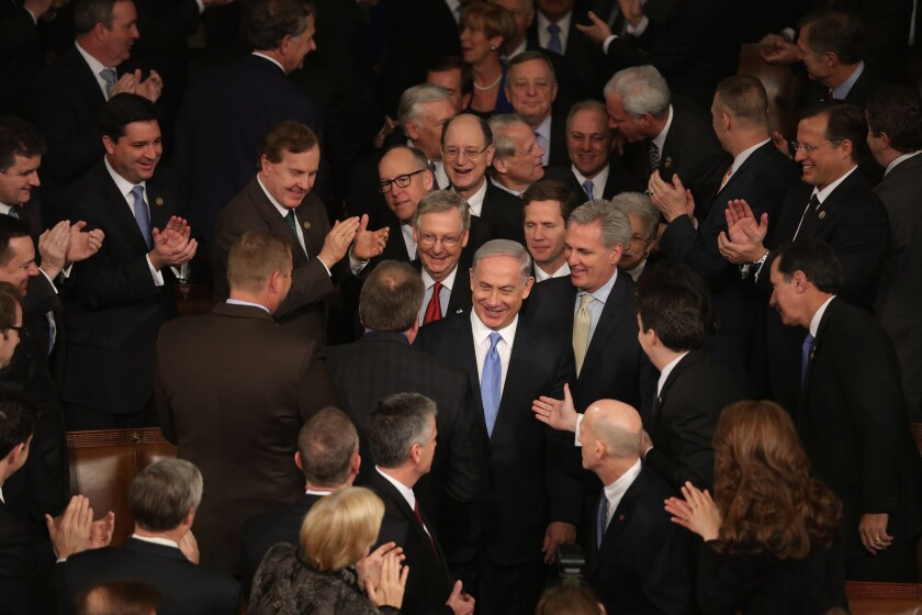 Israeli Prime Minister Benjamin Netanyahu, center, is greeted by members of Congress as he arrives to deliver a speech about nuclear talks with Iran.