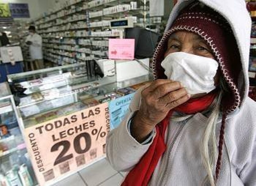 Josefina Martinez Silva, 70, adjusts her just-bought face shield at the Farmatodo pharmacy in downtown Tijuana on Tuesday.