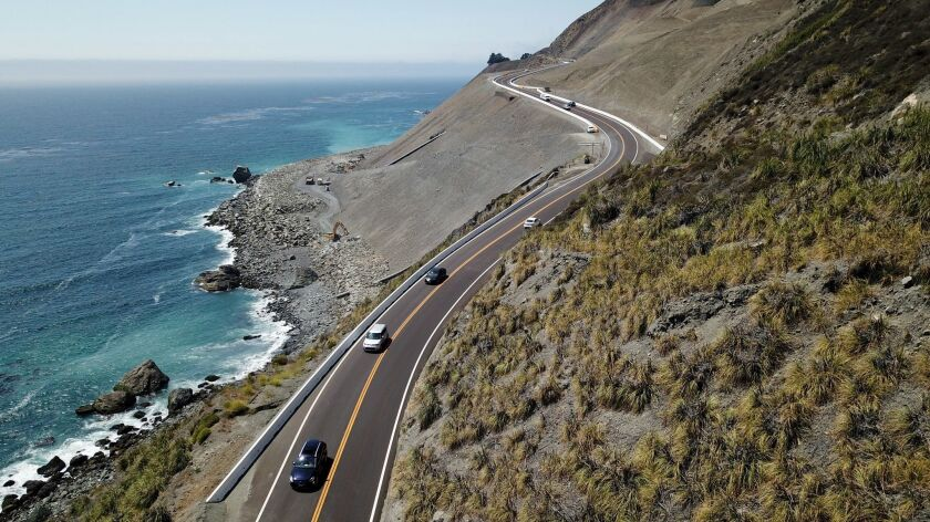 BIG SUR, CALIF. -- WEDNESDAY, AUGUST 1, 2018: Cars cruise along newly reconstructed roadway in the s