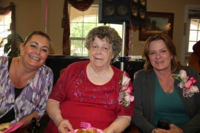 Sallie Ann Kittle (center) won a contest through Emeritus to be reunited with her daughter Marianna Burdette, right, whom she hadn't seen in almost nine years. Her daughter Elizabeth Heyde, left, lives in Carmel Valley.