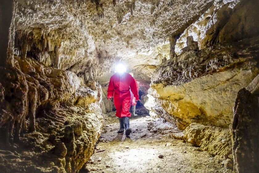 Moving through a wider section of the Gorna Slatinska cave in central Macedonia.