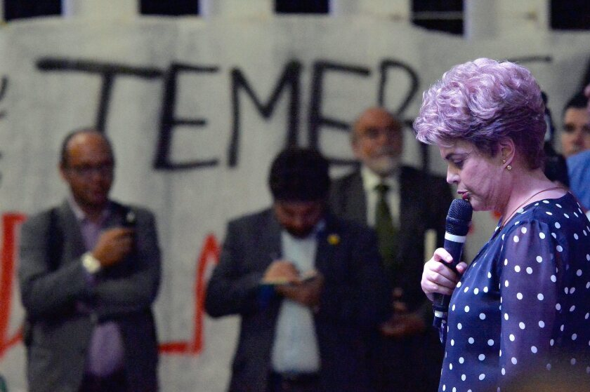"""Suspended Brazilian President Dilma Rousseff participates in the presentation of a book addressing her impeachment process, """"Resistance to the Coup of 2016,"""" in Brasilia, the capital, on May 30, 2016."""