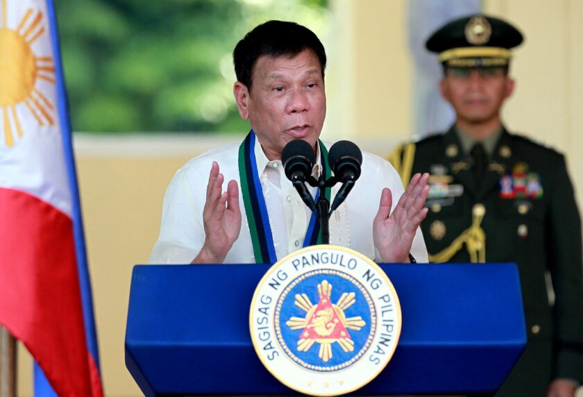 New Philippine President Rodrigo Duterte addresses the troops during the Change-of-Command ceremony for incoming Armed Forces chief Gen. Ricardo Visaya Friday, July 1, 2016, at Camp Aguinaldo in suburban Quezon city northeast of Manila, Philippines. Duterte won over four other candidates in the May