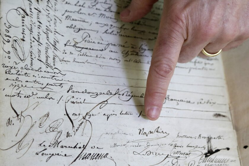 In this Monday, Feb. 8, 2016 photo, David Lowenherz  points to the signatures of Napoleon Bonaparte and to the left, Josephine de Beauharnais, on a marriage contract, in West Palm Beach, Fla.  Lowenherz, of Lion Heart Autographs, will put the document up for sale this week at the Palm Beach Jewelry