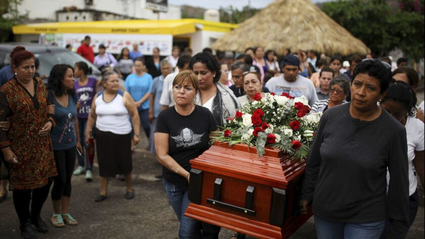 In this March 8, 2017 photo, members of the Solecito search group carry the coffin of Pedro Huesca,