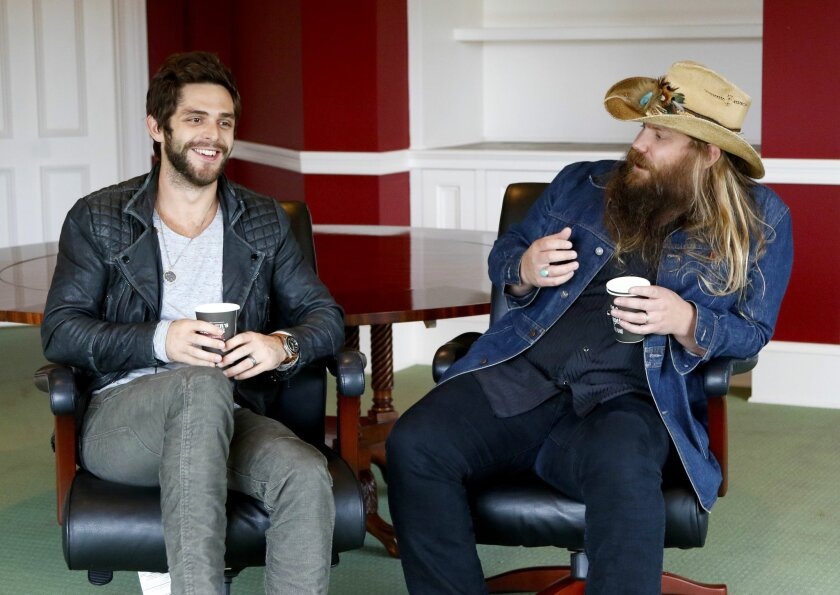 "In this Oct. 28, 2015 photo, Thomas Rhett, left, and Chris Stapleton appear in an interview in Nashville, Tenn. Rhett and Stapleton are both nominated for Country Music Association's new artist award. Rhett, 25, just released his second album, ""Tangled Up,"" and this is the second time he's been in"