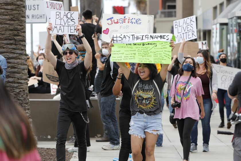 """Protesters shout """"No justice! No peace!"""" as they march during a protest against police brutality in Costa Mesa."""